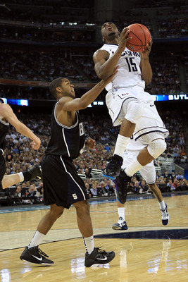 HOUSTON, TX - APRIL 04:  Kemba Walker #15 of the Connecticut Huskies goes to the basket against Ronald Nored #5 of the Butler Bulldogs during the National Championship Game of the 2011 NCAA Division I Men's Basketball Tournament at Reliant Stadium on Apri