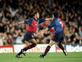 1 Mar 2000:  Rivaldo of Barcelona celebrates a goal against Porto with team mate Luis Figo during the UEFA Champions League group A match at the Nou Camp in Barcelona, Spain. Barcelona won 4-2. \ Mandatory Credit: Shaun Botterill /Allsport