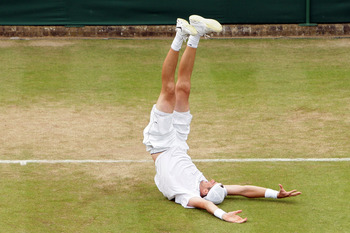 LONDON, ENGLAND - JUNE 24:  John Isner of USA celebrates winning on the third day of his first round match against Nicolas Mahut of France on Day Four of the Wimbledon Lawn Tennis Championships at the All England Lawn Tennis and Croquet Club on June 24, 2