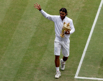 LONDON, ENGLAND - JULY 04:  Rafael Nadal of Spain lifts the Championship trophy after winning the Men's Singles Final match against Tomas Berdych of Czech Republic on Day Thirteen of the Wimbledon Lawn Tennis Championships at the All England Lawn Tennis a