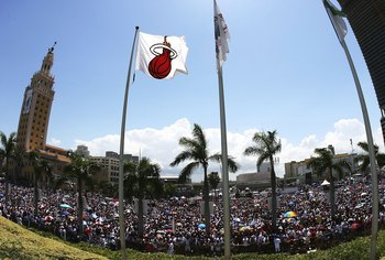 MIAMI - JUNE 23:  An estimated crowd of 250,000 people showed up to help celebrate with the Miami Heat during the victory parade and celebration at American Airlines Arena on June 23, 2006 in Miami, Florida. NOTE TO USER: User expressly acknowledges and a