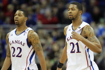 KANSAS CITY, MO - MARCH 11:  Marcus Morris #22 and Markieff Morris #21 of the Kansas Jayhawks walk on the court during their semifinal game against the Colorado Buffaloes in the 2011 Phillips 66 Big 12 Men's Basketball Tournament at Sprint Center on March