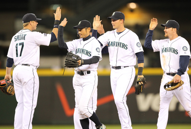 SEATTLE, WA - APRIL 12:  L to R:  Justin Smoak #17, Ichiro Suzuki #51, Michael Saunders #55, and Ryan Langerhans #12 of the Seattle Mariners celebrate after defeating the Toronto Blue Jays 3-2 at Safeco Field on April 12, 2011 in Seattle, Washington. (Pho