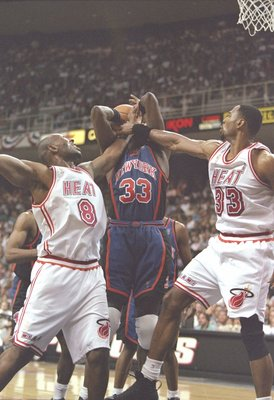 18 May 1997:  Center Patrick Ewing of the New York Knicks fight for the ball with center Alonzo Mourning and guard Isaac Austin of the Miami Heat during a playoff game at the Miami Arena in Miami, Florida.  The Heat won the game 101-90. Mandatory Credit: