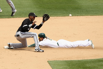 OAKLAND, CA - MAY 15:  Coco Crisp #4 of the Oakland Athletics slides safely past Alexei Ramirez #10 of the Chicago White Sox to steal second base at Oakland-Alameda County Coliseum on May 15, 2011 in Oakland, California.  (Photo by Ezra Shaw/Getty Images)