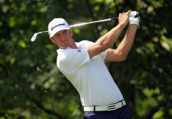 DUBLIN, OH - JUNE 02:  Dustin Johnson hits his tee shot on the 14th hole during the first round of the Memorial Tournament presented by Nationwide Insurance at the Muirfield Village Golf Club on June 2, 2011 in Dublin, Ohio.  (Photo by Scott Halleran/Gett