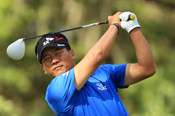 PONTE VEDRA BEACH, FL - MAY 15:  K.J. Choi of South Korea hits his tee shot on the 11th hole during the final round of THE PLAYERS Championship held at THE PLAYERS Stadium course at TPC Sawgrass on May 15, 2011 in Ponte Vedra Beach, Florida.  (Photo by St