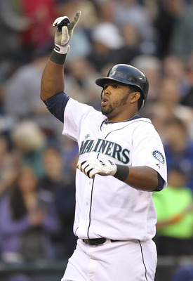 SEATTLE - JUNE 02:  Carlos Peguero #8 of the Seattle Mariners crosses home plate after hitting his second home run of the game against the Tampa Bay Rays at Safeco Field on June 2, 2011 in Seattle, Washington. (Photo by Otto Greule Jr/Getty Images)