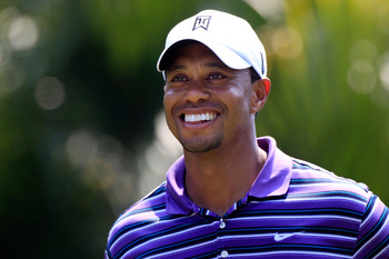 PONTE VEDRA BEACH, FL - MAY 10:  Tiger Woods smiles as he looks on during a practice round prior to the start of THE PLAYERS Championship held at THE PLAYERS Stadium course at TPC Sawgrass on May 10, 2011 in Ponte Vedra Beach, Florida.  (Photo by Sam Gree