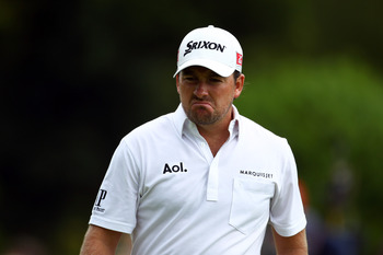 NEWPORT, WALES - JUNE 04:  Graeme McDowell of Northern Ireland reacts to missing a putt on the 4th green during the third round of the Saab Wales Open on the Twenty Ten course at The Celtic Manor Resort on June 4, 2011 in Newport, Wales.  (Photo by Richar