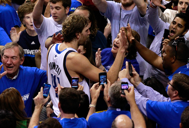 DALLAS, TX - JUNE 09:  Dirk Nowitzki #41 of the Dallas Mavericks celebrates with fans after the won 112-103 against the Miami Heat in Game Five of the 2011 NBA Finals at American Airlines Center on June 9, 2011 in Dallas, Texas.  NOTE TO USER: User expres
