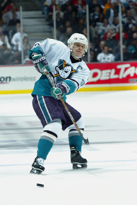 ANAHEIM, CA - APRIL 14:  Paul Kariya #9 of the Mighty Ducks of Anaheim makes a pass against the Detroit Red Wings during round one of the NHL 2003 Stanley Cup playoffs at the Arrowhead Pond of Anaheim on April 14, 2003 in Anaheim, California. (Photo by Do