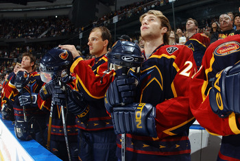 ATLANTA - OCTOBER 9:  Center Kamil Piros #22 and the rest of the Atlanta Thrashers pay tribute during a ceremony to memorializes the untimely passing of Thrasher center Dan Snyder #37, before the game against the Columbus Blue Jackets at Philips Arena on