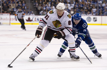 VANCOUVER, CANADA - APRIL 13: Alexandre Burrows #14 of the Vancouver Canucks tries to stop Marian Hossa #81of the Chicago Blackhawks from getting to the front of the net during the third period in Game One of the Western Conference Quarterfinals during th