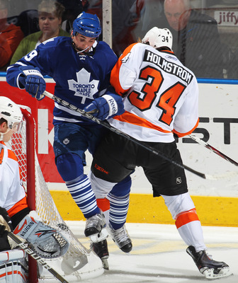 LONDON, CANADA - SEPTEMBER 23:  Danny Richmond #49 of the Toronto Maple Leafs takes a big hit from Ben Holmstrom #34 of the Philadelphia Flyers in a preseason game on September 23,2010 at the John Labatt Centre in London, Ontario. The Leafs defeated the F