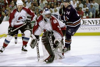 4 May 1998:  Defenseman Uwe Krupp and goaltender Patrick Roy of the Colorado Avalanche in action against center Mats Lindgren of the Edmonton Oilers during an NHL Western Conference Semi-final game at the McNichols Sports Arena in Denver Colorado. The Oil