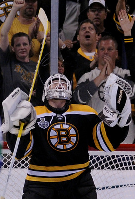 BOSTON, MA - JUNE 08:  Tim Thomas #30 of the Boston Bruins celebrates after defeating the Vancouver Canucks in Game Four of the 2011 NHL Stanley Cup Final at TD Garden on June 8, 2011 in Boston, Massachusetts. The Boston Bruins defeated the Vancouver Canu