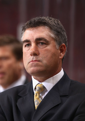 GLENDALE, AZ - MARCH 24:  Head coach  Dave Tippett of the Phoenix Coyotes watches from the bench during the NHL game against the Columbus Blue Jackets at Jobing.com Arena on March 24, 2011 in Glendale, Arizona. The Coyotes defeated the Blue Jackets 3-0.