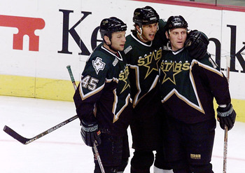 21 May 2000:  Mike Modano #9 and Brendan Morrow #45 celebrate with Brett Hull #16 of the Dallas Stars after he scored the second goal against the Colorado Avalanche in the first period during game four of the Western Conference Finals at the Pepsi Center