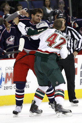 COLUMBUS,OH - SEPTEMBER 28:  Tom Sestito #23 of the Columbus Blue Jackets fights with Drew Bagnall #42 of the Minnesota Wild during the first period on September 28, 2010 at Nationwide Arena in Columbus, Ohio.  (Photo by John Grieshop/Getty Images)