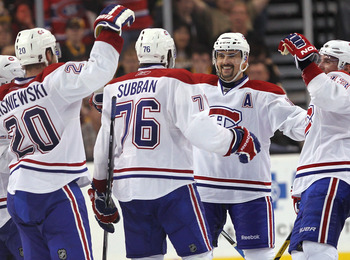 BOSTON, MA - APRIL 27:   Tomas Plekanec #14 of the Montreal Canadiens celebrates with teammate P.K. Subban #76 who scored a goal in the third period against the Boston Bruins in Game Seven of the Eastern Conference Quarterfinals during the 2011 NHL Stanle