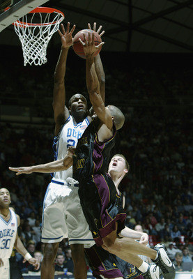 SALT LAKE CITY - MARCH 22:  Casey Sanders #20 of Duke goes up to block a shot by Central Michigan during the second round of the NCAA Tournament on March 22, 2003 at the Huntsman Center in Salt Lake City, Utah. Duke won 86-60.  (Photo by Jeff Gross/Getty