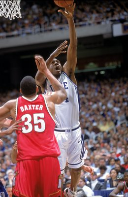 10 Mar 2001: Nate James #14 of the Duke Blue Devils takes a shot as he is guarded Lonny Baxter #35 of the Maryland Terrapins during the ACC Tournament at the Georgia Dome in Atlanta, Georgia. The Blue Devils defeated the Terrapins 84-82.Mandatory Credit: