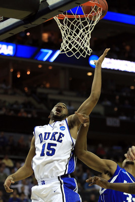 CHARLOTTE, NC - MARCH 18:  Josh Hairston #15 of the Duke Blue Devils lays the ball up against the Hampton Pirates during the second round of the 2011 NCAA men's basketball tournament at Time Warner Cable Arena on March 18, 2011 in Charlotte, North Carolin