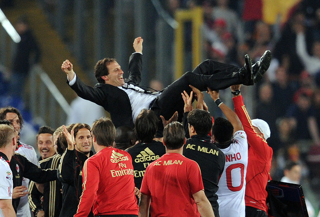 ROME, ITALY - MAY 07:  Massimiliano Allegri, head coach of Milan celebrates the victory after the Serie A match between AS Roma and AC Milan at Stadio Olimpico on May 7, 2011 in Rome, Italy.  (Photo by Giuseppe Bellini/Getty Images)