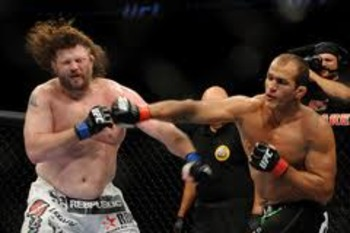 Junior dos Santos lands a solid right hand on the chin of Roy Nelson