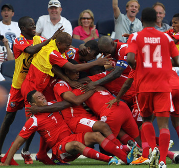 KANSAS CITY, KS - JUNE 14:  Blas Perez #7 of Panama is swarmed by teammates after scoring during the GoldCup game against Canada on June 14, 2011 at LiveStrong Sporting Park in Kansas City, Missouri.  (Photo by Jamie Squire/Getty Images)