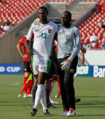 TAMPA, FL - JUNE 11:  Jean-Luc Lambourde #13 of Team Guadeloupe is comforted by Franck Grandel #1 after receiving a red card against Team Canada during the CONCACAF Gold Cup Match at Raymond James Stadium on June 11, 2011 in Tampa, Florida.  (Photo by J.