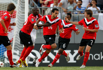 TAMPA, FL - JUNE 11:  Dwayne De Rosario #14 of Team Canada celebrates a goal against Team Guadeloupe during the CONCACAF Gold Cup Match at Raymond James Stadium on June 11, 2011 in Tampa, Florida.  (Photo by J. Meric/Getty Images)