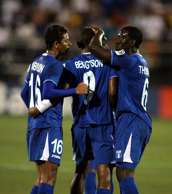 MIAMI, FL - JUNE 10:  Jerry Bengstson #9 of Honduras celebrates a goal against Grenada with teammates at FIU Stadium on June 10, 2011 in Miami, Florida.  (Photo by Marc Serota/Getty Images)