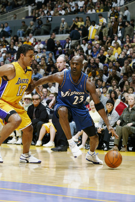 LOS ANGELES - MARCH 28:  Michael Jordan #23 of the Washington Wizards drives against Rick Fox #17 of the Los Angeles Lakers during the game at Staples Center on March 28, 2003 in Los Angeles, California.  The Lakers won 108-94.  NOTE TO USER: User express