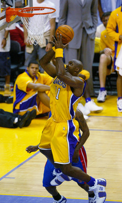LOS ANGELES - JUNE 8:  Karl Malone #11 of the Los Angeles Lakers shoots against the Detroit Pistons in Game two of the 2004 NBA Finals at Staples Center on June 8, 2004 in Los Angeles, California.  The Lakers won in overtime 99-91.  NOTE TO USER: User exp