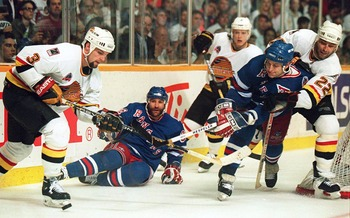 11 JUN 1994: CANUCKS'' DEFENSEMAN BRENT HEDICAN CARRIES HANDLES THE PUCK DURING THE THIRD PERIOD IN GAME SIX OF THE STANLEY CUP FINALS IN VANCOUVER, BRITISH COLUMBIA. SURROUNDING HEDICAN ARE, FROM LEFT TO RIGHT,  GLENN ANDERSON, PAVEL BURE, ADAM GRAVES AN