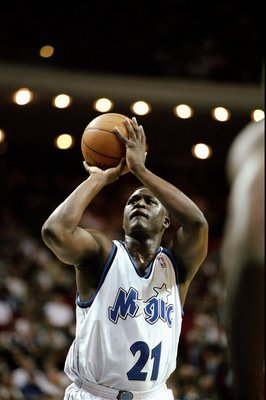 1 Mar 1999:  Dominique Wilkins #21 of the Orlando Magic shooting a free throw during the game against the Atlanta Hawks at the Orlando Arena in Orlando, Florida. The Magic defeated the Hawks 70-67.   Mandatory Credit: Andy Lyons  /Allsport