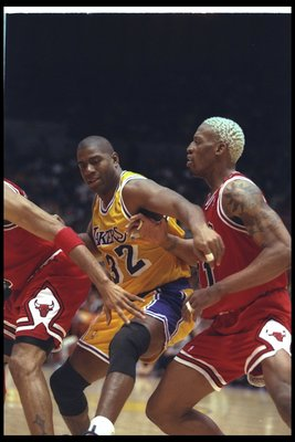 2 Feb 1996:  Guard Earvin (Magic) Johnson of the Los Angeles Lakers works against Chicago Bulls forward Dennis Rodman during a game at the Great Western Forum in Inglewood, California.  The Bulls won the game, 99-84. Mandatory Credit: ALLSPORT USA  /Allsp