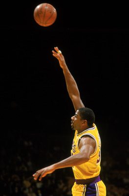 LOS ANGELES - 1987:  Magic Johnson #32 of the Los Angeles Lakers shoots a hook shot during an NBA game at the Great Western Forum in Los Angeles, California in 1987. (Photo by: Jonathan Daniel/Getty Images)