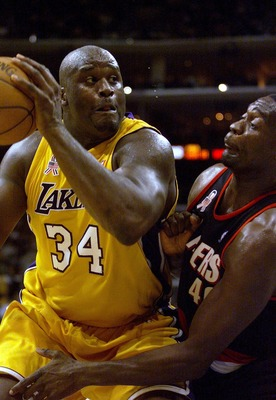 30 Oct 2001: Shaquille O''Neal #34 of the Los Angeles Lakers goes up against Shawn Kemp #40 of the Portland Trail Blazers at the Lakers'' home opener at Staples Center in Los Angeles, California. DIGITAL IMAGE.   NOTE TO USER:  User expressly acknowledges