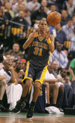 BOSTON - APRIL 23:  Reggie Miller #31 of the Indiana Pacers receives a pass against the Boston Celtics in Game one of the Eastern Conference Quarterfinals during the 2005 NBA Playoffs at the FleetCenter on April 23, 2005 in Boston, Massachusetts.  The Cel