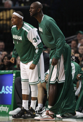 BOSTON, MA - JANUARY 25:  Paul Pierce #34 and Kevin Garnett #5 of the Boston Celitcs cheer on their teammates in the second half against the Cleveland Cavaliers on January 25, 2011 at the TD Garden in Boston, Massachusetts. The Celtics defeated the Cavali