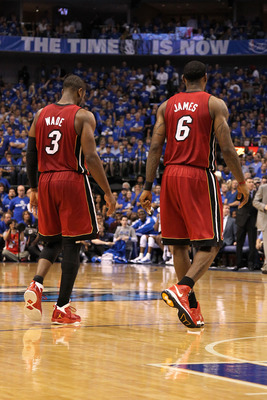 DALLAS, TX - JUNE 07:  (L-R) Dwyane Wade #3 and LeBron James #6 of the Miami Heat walk towards the bench against the Dallas Mavericks in Game Four of the 2011 NBA Finals at American Airlines Center on June 7, 2011 in Dallas, Texas. The Mavericks won 86-83