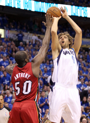 DALLAS, TX - JUNE 07:  Dirk Nowitzki #41 of the Dallas Mavericks makes the first basket of the game over Joel Anthony #50 of the Miami Heat in the first quarter in Game Four of the 2011 NBA Finals at American Airlines Center on June 7, 2011 in Dallas, Tex