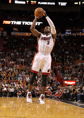 MIAMI, FL - DECEMBER 04: Dwyane Wade #3 of the Miami Heat shoots a jumpshot during a game against the Atlanta Hawks at American Airlines Arena on December 4, 2010 in Miami, Florida. NOTE TO USER: User expressly acknowledges and agrees that, by downloading