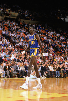 1988:  Manute Bol #10 of the Golden State Warriors walks on the court during an NBA game in the 1988-89 season. NOTE TO USER: User expressly acknowledges and agrees that, by downloading and/or using this Photograph, User is consenting to the terms and con