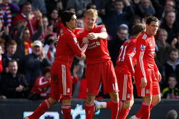 LIVERPOOL, ENGLAND - MARCH 06:  Dirk Kuyt of Liverpool celebrates scoring the opening goal with team mate Luis Suarez (L) during the Barclays Premier League match between Liverpool and Manchester United at Anfield on March 6, 2011 in Liverpool, England.