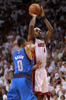 MIAMI, FL - JUNE 02:  LeBron James #6 of the Miami Heat attempts a shot against Shawn Marion #0 of the Dallas Mavericks in Game Two of the 2011 NBA Finals at American Airlines Arena on June 2, 2011 in Miami, Florida. NOTE TO USER: User expressly acknowled