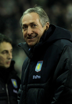 LIVERPOOL, ENGLAND - DECEMBER 06:  Aston Villa Manager Gerrard Houllier looks on prior to the Barclays Premier League match between Liverpool and Aston Villa at Anfield on December 6, 2010 in Liverpool, England.  (Photo by Mark Thompson/Getty Images)